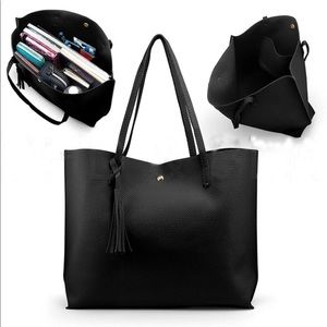 Women's large black shoulder tote bag with tassel